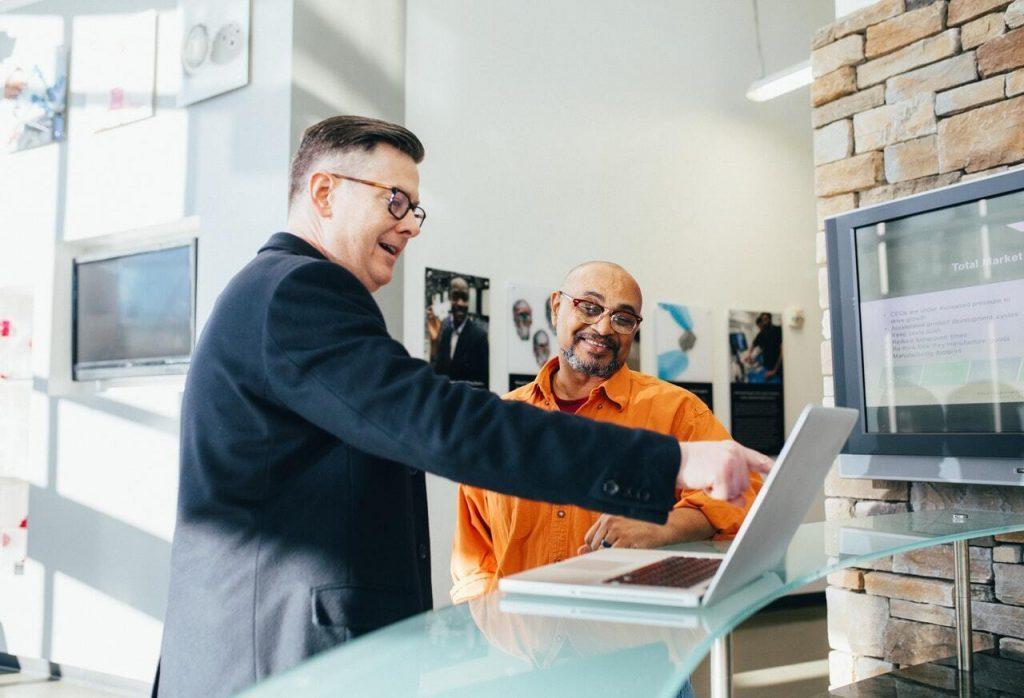 man pointing laptop